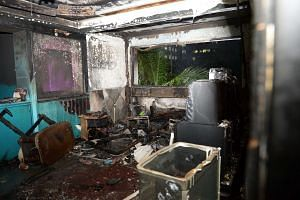 The aftermath of the fire that broke out in a fourth-storey flat at Block 750, Pasir Ris Street 71.