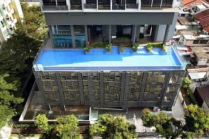 The entire fifth floor where the infinity pool is located at Cradels condominium in Lorong Limau plus the area where the glass panels fell are now closed. When The Straits Times visited the condominium at 3.15pm yesterday, workers were seen clearing