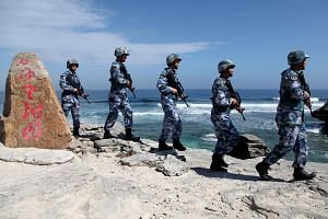 Chinese soldiers on patrol at Woody Island in the Paracels on January 29, 2016.
