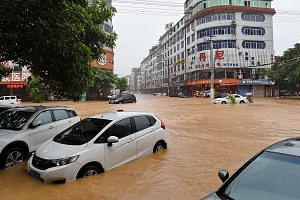A street in Putian flooded by Nepartak. More than 250mm of rain fell in about four hours in the city early yesterday.