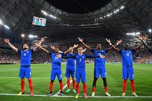 French players celebrate after beating Germany 2-0 in the Euro 2016 semi-final football match.