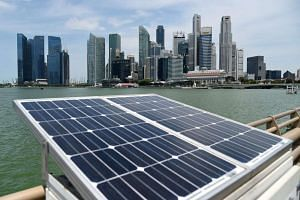 Solar panels used to power walkway lights are positioned along the Marina Bay.