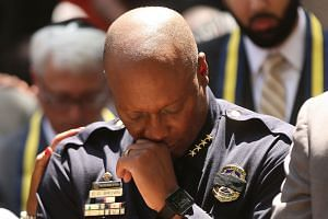 Dallas Police Chief David Brown pauses at a prayer vigil following the deaths of five police officers during a Black Lives Matter march on July 8.