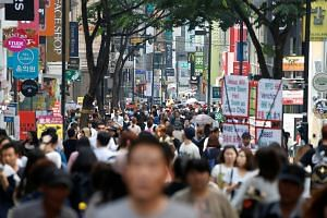 Pedestrians in the Myeongdong shopping district in Seoul on May 31.