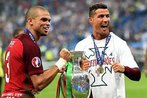 Pepe (left) and Cristiano Ronaldo of Portugal react after winning the Uefa Euro 2016 final against France at the Stade de France.