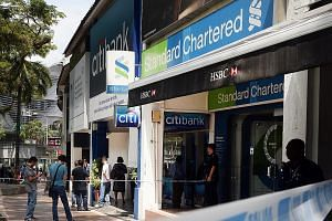 The suspect, a Canadian, fled Singapore last Thursday with $30,000 in cash after robbing StanChart's branch in Holland Village.