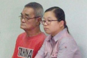 Teo Boon Tiak (left) at the Batam District Court on June 23, 2016.
