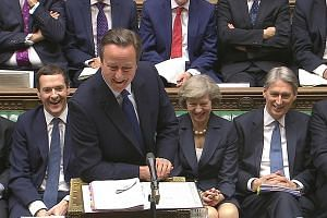 Mr Cameron, seen here with his successor Theresa May, making his final appearance as British prime minister in Parliament yesterday.