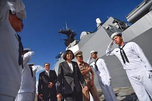 President Tsai about to board the Taiwanese navy warship, Kang Ding, at the naval base in Kaohsiung, southern Taiwan, yesterday before it set sail for Taiping Island in the South China Sea.