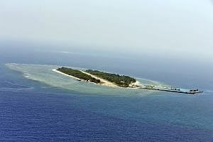 A handout photo provided by Taiwan shows an aerial photograph of Taiping Island, also known as Itu Aba Island in the South China Sea, on March 23.