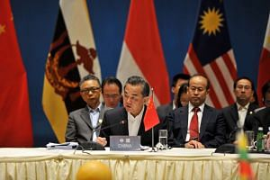 Chinese Foreign Minister Wang Yi (second from left) and foreign ministers from Asean-member nations attend a special Asean-China foreign ministers' meeting, on June 14, 2016.