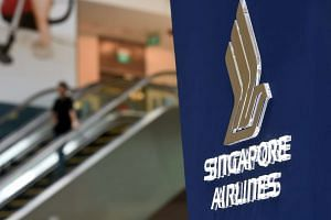 The Singapore Airlines logo is pictured at a promotional booth at Changi International Airport.