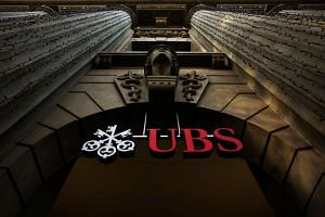 The logo of Swiss bank UBS is seen on a building in Zurich, Switzerland.