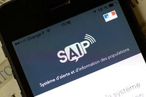 A smartphone with the logo of the SAIP app, on June 8, 2016.