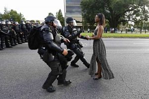 Protestor Ieshia Evans is detained by law enforcement near the headquarters of the Baton Rouge Police Department in Baton Rouge, Louisiana, US, July 9.