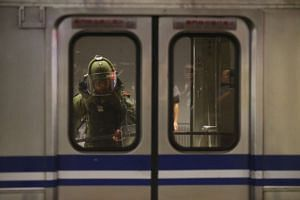 A bomb squad officer in protective gear enters the inside of a train carriage that was involved in a blast in Taipei, on July 8, 2016.