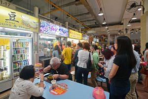 People queue up at the Hoo Kee Rice Dumplings stall at Amoy Street Food Centre, on July 15, 2016.