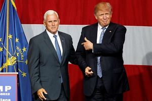 Trump (right) and Pence wave to the crowd at a campaign event in Indiana on July 12, 2016.