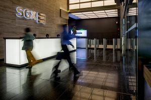 People walk through the reception of the SGX headquarters in Singapore.