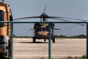 A Turkish military helicopter at Alexandroupolis airport, after landing there carrying eight officers seeking asylum.