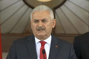 Turkey's Prime Minister Binali Yildirim speaks during a news conference, following an overnight attempted Turkish military coup, in Ankara, Turkey July 16, 2016.