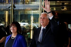 Mr Pence with his wife, Karen, after being named Mr Trump's running mate.