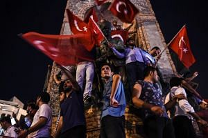 Pro-Erdogan supporters gather at Taksim square in Istanbul to support the government, following a failed coup attempt.