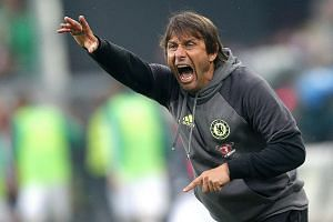 Chelsea manager Antonio Conte showing his displeasure during the 0-2 loss to Rapid at the new Allianz Stadion. He is known to send things flying through the air when angered.