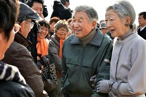 Emperor Akihito and Empress Michiko meeting well-wishers in Kanagawa prefecture in this 2013 photo. The soft-spoken monarch has been known to kneel to speak eye-to-eye to the injured and those in wheelchairs.