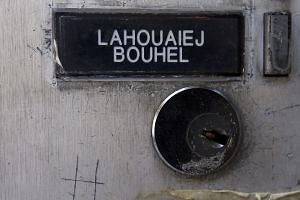 The name Mohamed Lahoualej Bouhlel is seen on a plate outside the building where he lived in Nice, France.