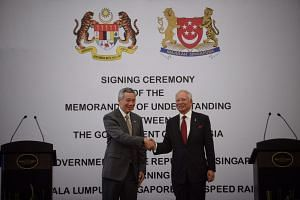 Singapore PM Lee Hsien Loong and Malaysia PM Najib Razak shaking hands after signing an MOU for the High Speed Rail between Singapore and KL, on July 19, 2016,