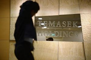 A man walks past the Temasek Holdings office in February 2015.