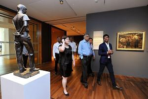Sri Lankan Prime Minister Wickremesinghe (centre, in light blue) taking a tour of the National Gallery yesterday. Mr Wickremesinghe said he was impressed by Singapore's development and was keen to find out how colonial-era buildings were conserved.