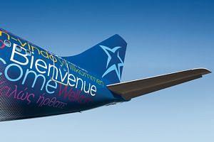 A plane featuring the Air Transat logo.