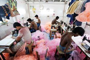 Employees work inside a garment factory in Mumbai, India, June 1, 2016.