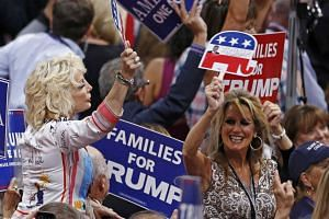 Women hold Trump signs at the Republican National Convention in Cleveland, Ohio, on July 21.