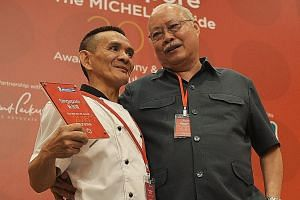 Singapore's first Michelin-starred hawker stalls are Hong Kong Soya Sauce Chicken Rice & Noodle at Chinatown Food Complex run by Mr Chan Hon Meng (left), 51; and Hill Street Tai Hwa Pork Noodle in Crawford Lane, run by Mr Tang Chay Seng, 70. The two