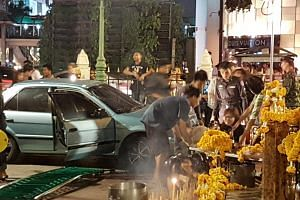 At least seven people were injured when a driver had a seizure and her car ploughed into Erawan shrine on July 22, 2016.