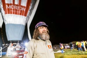 Russian adventurer Fedor Konyukhov in front of his balloon as it is inflated before the start of his attempt to break the world record, on July 12, 2016.