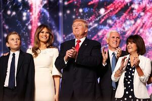 On stage at the Republican National Convention on July 21, 2016, in Cleveland are (from left) Barron Trump, Melania Trump, Republican presidential candidate Donald Trump, Republican vice-presidential candidate Mike Pence and his wife Karen.