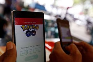 A man shows his Pokemon Go game application on his mobile phone in Banda Aceh, Indonesia, on July 20, 2016.