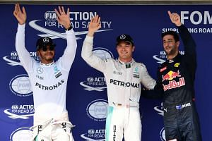 Ricciardo (right) after the qualifying session, with Britain's Lewis Hamilton (left) and Germany's Nico Rosberg.