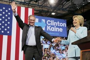 US Senator Tim Kaine acknowledges supporters after Democratic US presidential candidate Hillary Clinton introduces him as her vice-presidential running mate.