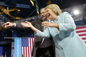 Clinton arrives on stage with US Senator Tim Kaine as her vice-presidential running mate.