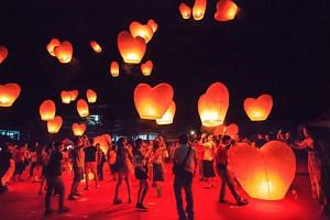 Tourists and locals gathering together to celebrate Pingxi Sky Lantern Festival in Taipei as Taiwan goes the extra mile to attract Muslims to boost tourist numbers.