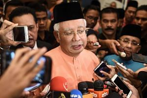 Malaysia's Prime Minister Najib Razak speaks to the media after an event in Kuala Lumpur on July 21, 2016.
