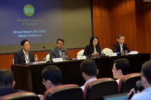 Monetary of Singapore annual report press conference at MAS building on 25 July 2016. From left: Ong Chong Tee, deputy managing director, Ravi Menon, managing director, Jacqueline Loh, deputy managing director and Andrew Khoo, deputy managing directo