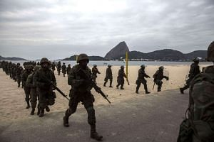 Troops from the Brazilian Navy perform training exercises at Flamengo beach, in the south of Rio de Janeiro in preparation for the Olympics.