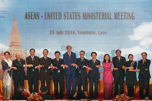 US Secretary of State John Kerry (center) links his hands with Asean Foreign Ministers and delegates during the Asean-US meeting as part of the 49th Asean Foreign Ministers Meeting and related meetings in Vientiane, Laos, July 25.