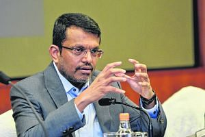 MAS managing director Ravi Menon at its annual report media conference on July 25.